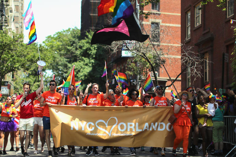 NEW YORK, NY - JUNE 26: A view of marchers with a tribute to Orlando sign during the New York City Pride 2016 march on June 26, 2016 in New York City. (Photo by Neilson Barnard/Getty Images)